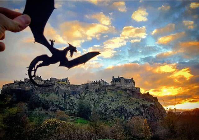 A dragons flies by Edinburgh Castle