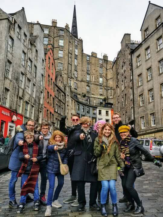 A Harry Potter tour dressed in cosplay poses on Victoria Street
